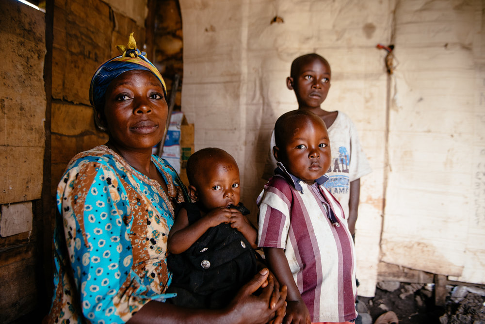 photo:Corinna Robbins for Mercy Corps,Goma, DRC. Furaha Faida,pictured here with three of her four children, fled her hometown with her children after soldiers looted their home and subjected her to violent sexual assault.