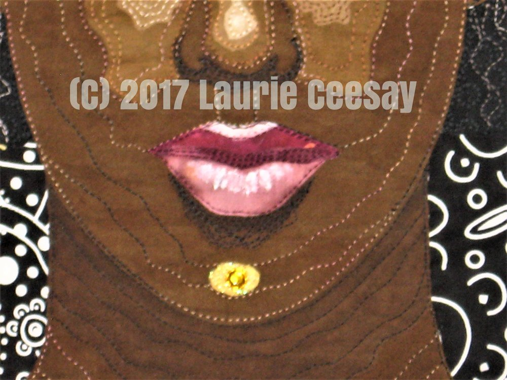 Photo of the mouth detail using Inktense pencils for shadowing and white fabric paint for highlighting. Thread painting adds to the depth of the mouth. The next project due July 31st is Nursery Rhythms with a twist of a back story. I am leaning towards a co-dependent lamb who follows Mary around! Snort!