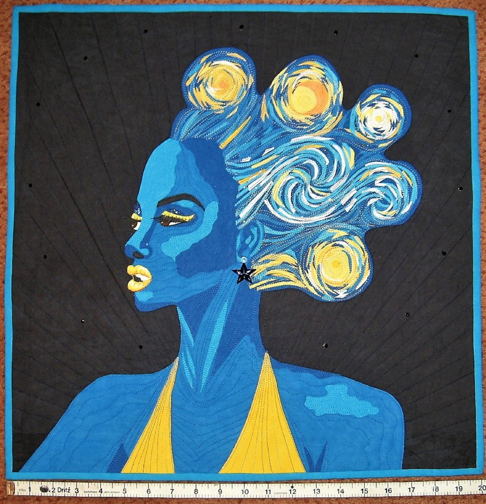 "In both quilts I used three gradations of one color for the facial depth and highlighting. In the new ""Glow in the Dark"" version there was low contrast because I wanted it subtle to appear as if it was under a black light. IN ""Vincentia"" I was given the three blues as part of the challenge."