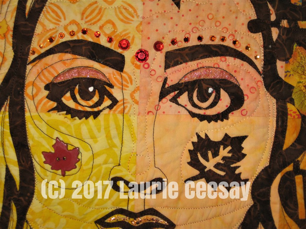 This is a close-up of the face. I used red, orange, orange yellow and gold rhinestones above the brows. I used an orange glitter polish on the eyelids and a chunky gold nail polish on the mouth.