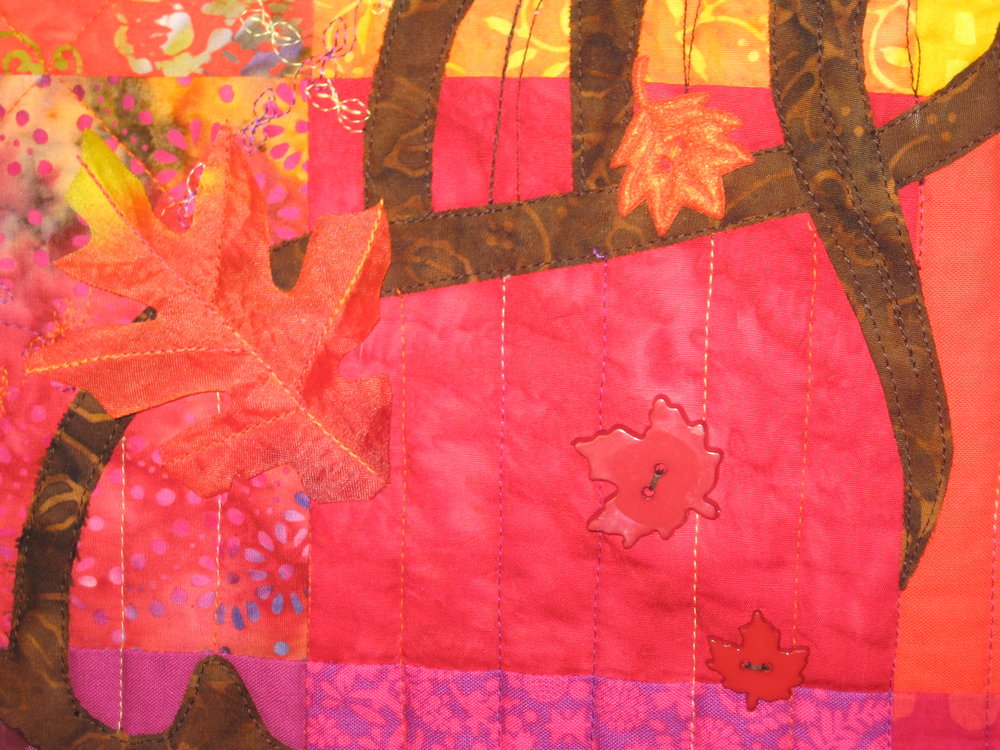 More silk leaves, plastic buttons and felt buttons.    I love autumn colors and this quilt makes me happy!
