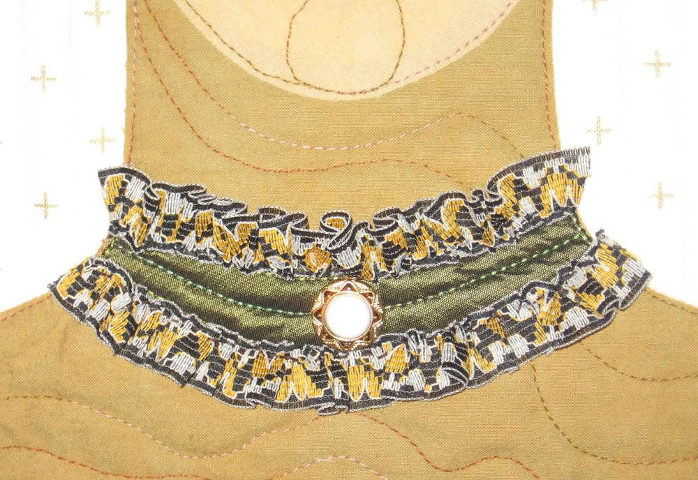 Since there wasn't room for a garment I Pinterest searched steampunk clothing again to see what I could add to the neck area and found a ruffled choker necklace. I used a taffeta olive green for the base and some old fashioned looking trim which I hand gathered and a repurposed button from my stash. Success!