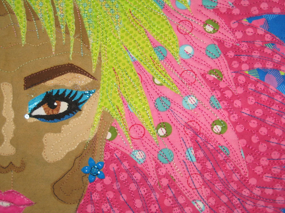 This is a close up of the face and hair. I used velvet for the lips and lots of turquoise embellishments to enhance the eyes and hair and to make the earrings.