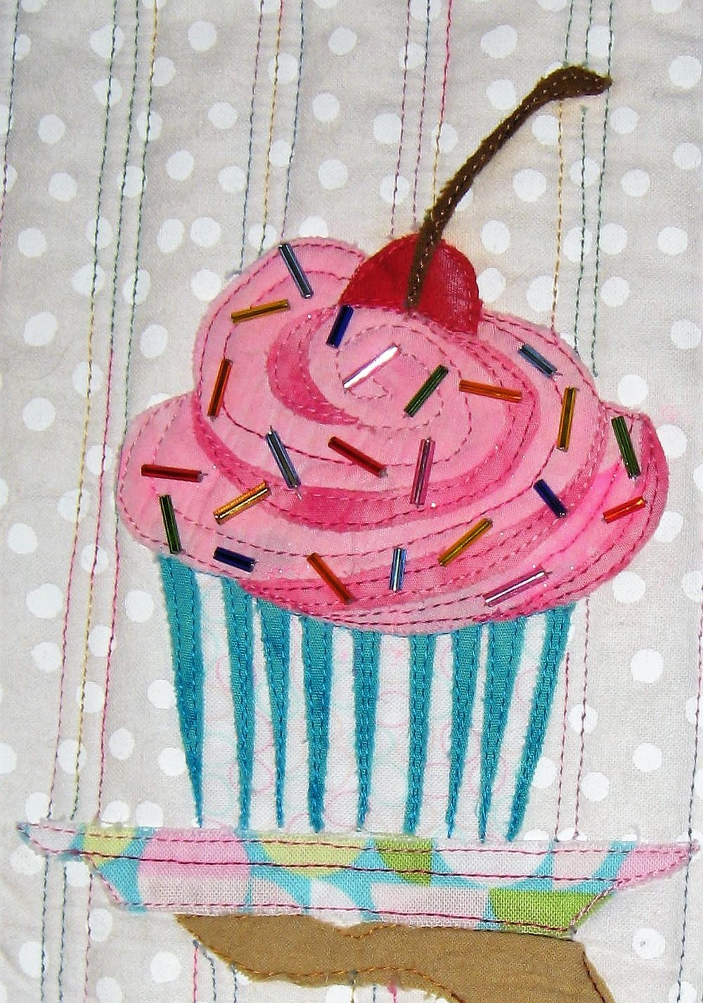 The cupcake has lots of detail and bugle beans sewn to it to represent sprinkles!!