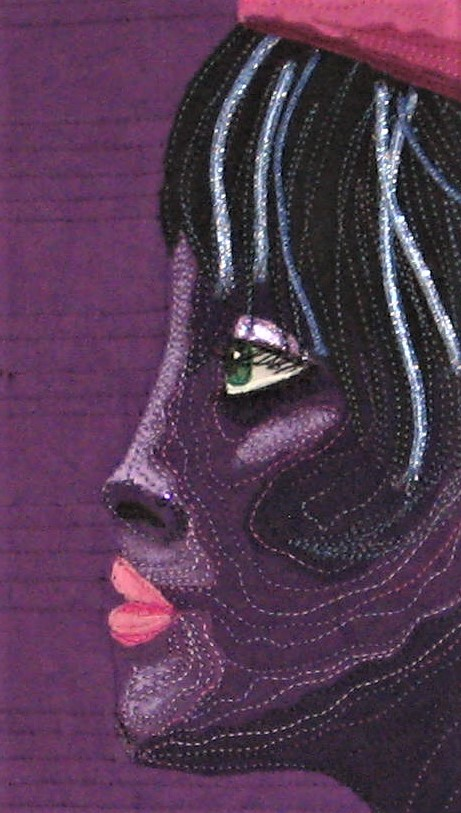"In the close up of the face I used light purple nail polish on the eye lid and some lavender fabric paint to add highlights to the face. The eye is detailed with a green Pigma Micron pen and a dot of white matte paint for the eye reflection.  I did a crosshatch quilt design on the garment to look like a quilted jacket since she lives in Minnesota like Prince and needs to be warm in the cold weather!! I added a necklace of various purple beads.  I added the word ""Prince"" in his recognizable font and quilted the background to look like sheet music including a few musical notes in the mix!!  July 2nd is the deadline for entering and July 13th is the day people find out if their quilt is accepted into the traveling challenge. The last three years my quilt has made the cut so I hope this year I can do the same. I am adding to this post on the morning of July 3, 2018 and on Cherrywood Fabrics Facebook page they stated there are 388 entries and they are not telling how many quilts they will select for the traveling challenge. In ten days I will know..."