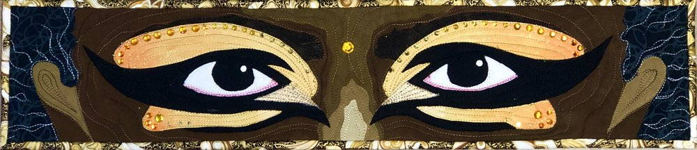 And finally, this is entry quilt 3 based on my small quilt The Eyes Have It which I made in 2017. I did have to redraw this quilt to get to the larger size. Lots on bling from rhinestones in a variety of sizes and glitter paint. In the original quilt I couched black bouche yarn in the hair for added texture. I wanted to add yarn to this quilt but said not to this idea because this about the eyes not the hair.