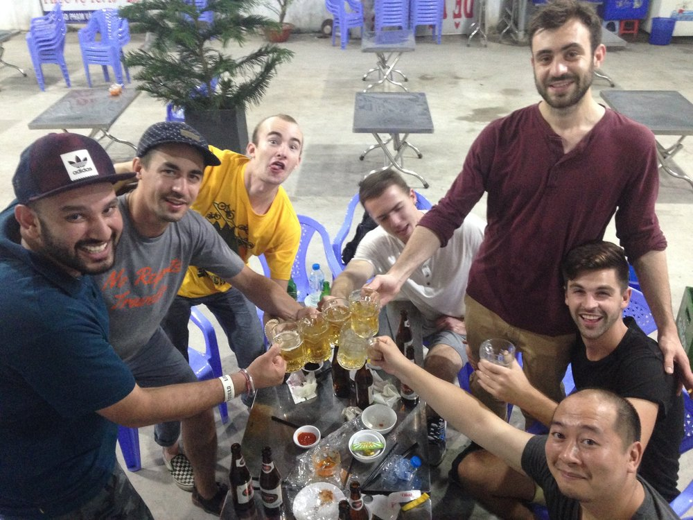 """Some of the gang at our most common food and beer spot in Go Vap. We nicknamed it """"The Clean Concrete Place"""" because it has the cleanest and brightest concrete in all of Vietnam."""