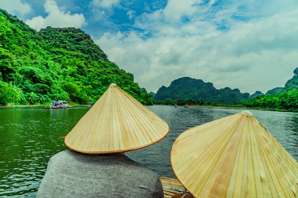 """Bromance paddle boat ride around the """"Freshwater Halong Bay"""" in Ninh Binh."""
