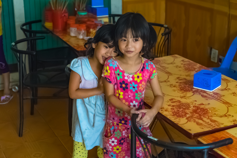 Two sisters who were so shy around us when we stopped in their parents store for a soda.