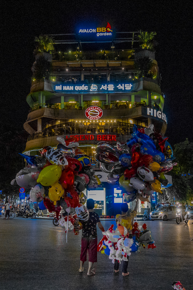Balloon salesmen at one of the busiest roundabouts in Hanoi