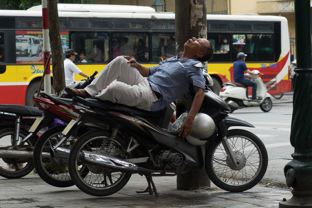 I have a fascination with the way people across the world sleep in busy public places like Hanoi.