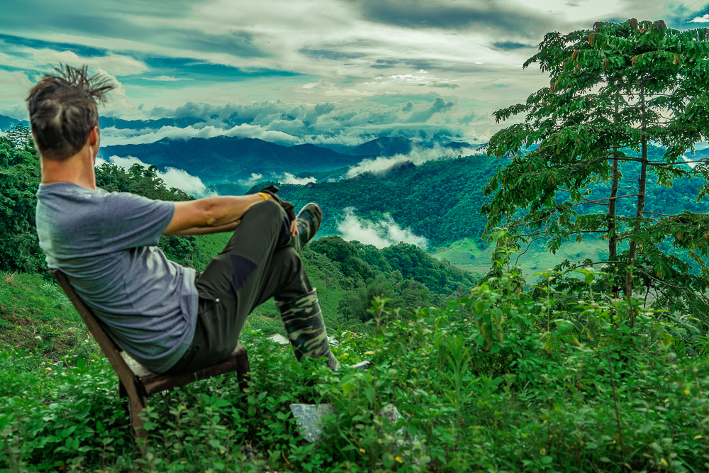 Using a popular Vietnamese tiny chair to practice my patience perched on top a mountain!
