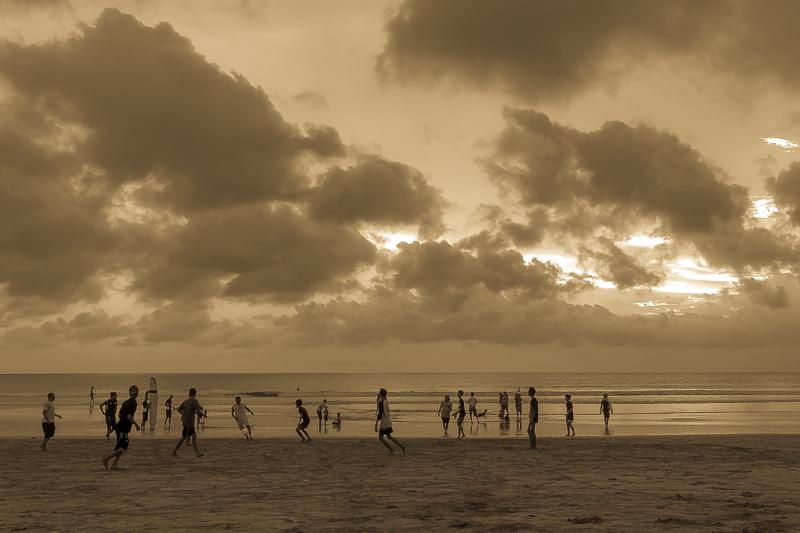 Sunset soccer on the beach