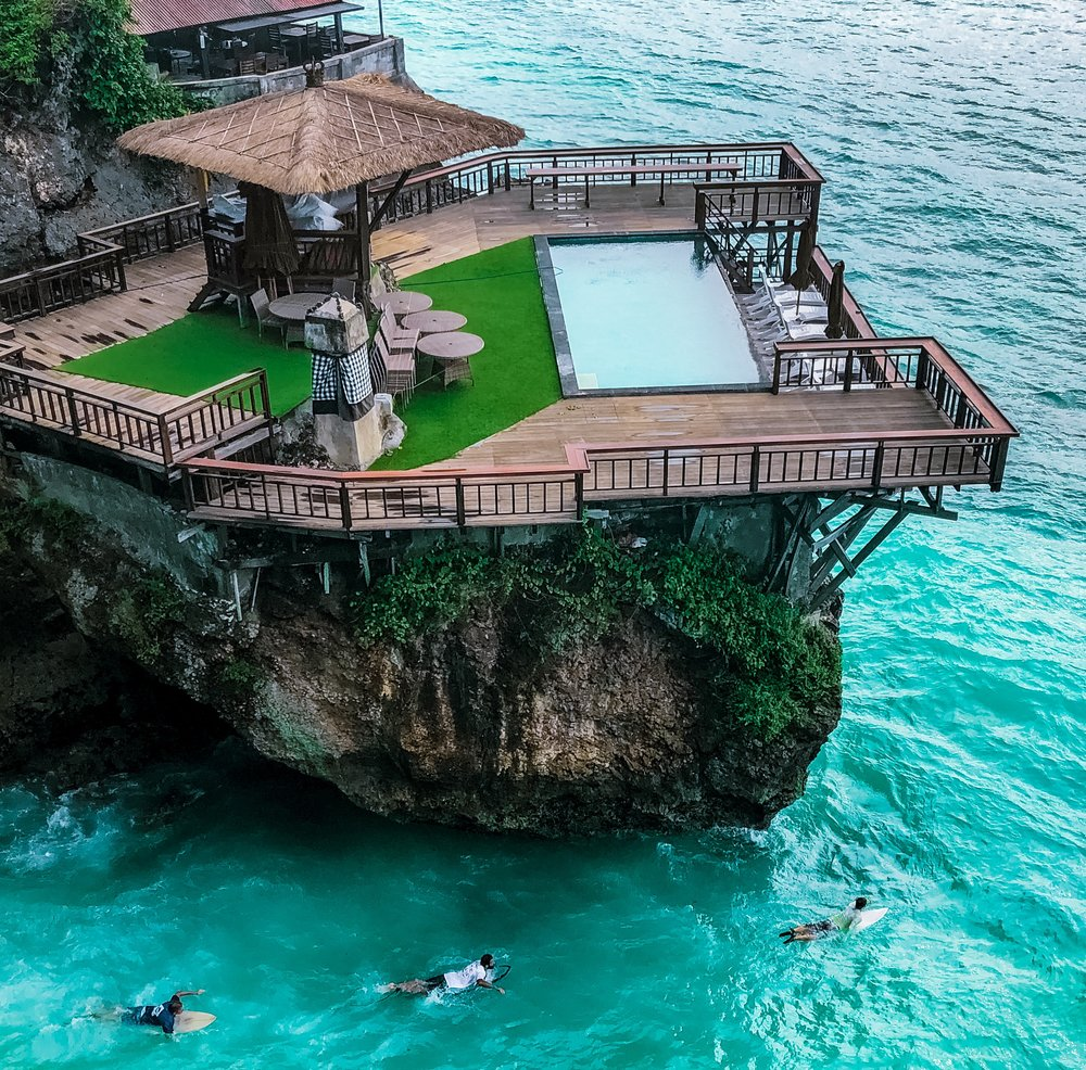 I'd rather be one of the surfer's below than the photographer of this picture in Uluwatu, Bali