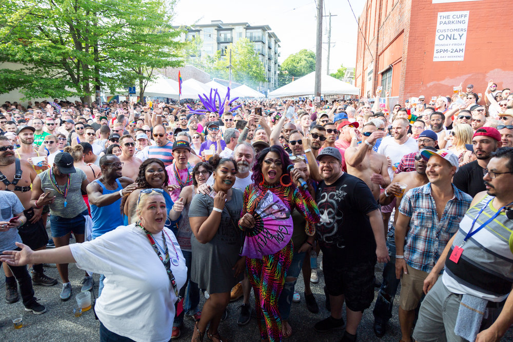 """Kennedy Davenport taking a """"group photo"""" with the crowd at Cuff"""