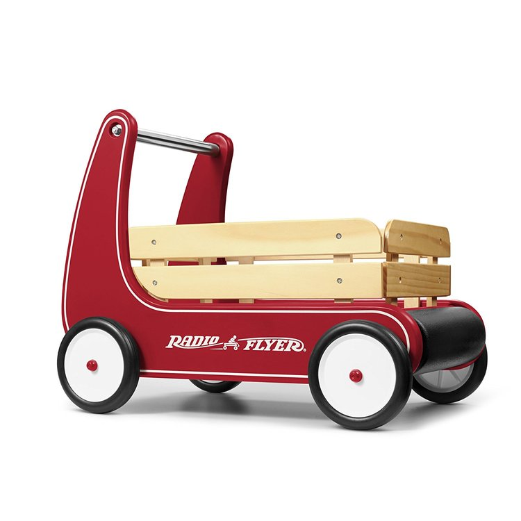 A red wagon that can be used as a walker and then transitioned into a play cart. A perfect toy for a Montessori baby, infant or toddler.