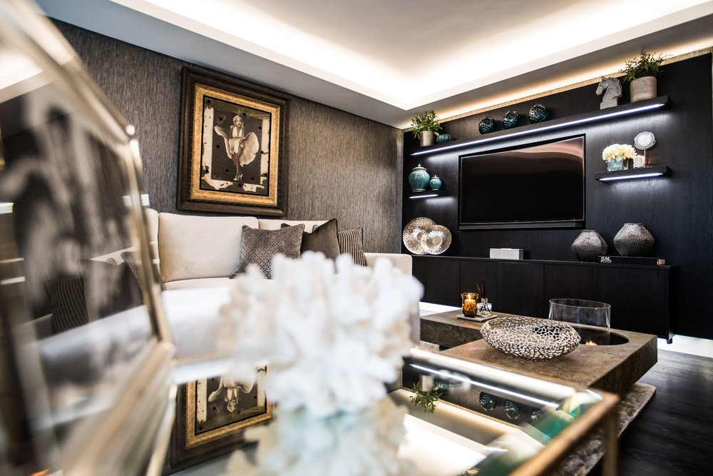 Chelsea Garden Flat - This lower ground garden flat off of the Kings Road in Chelsea was transformed into a masculine and refined living space. With an eclectic art collection lining the walls, this property defines liveable luxury.