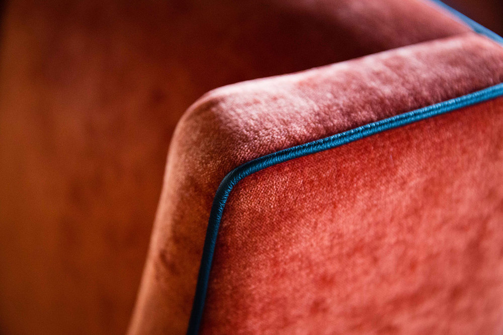 orange-upholstered-armchair-2.jpg