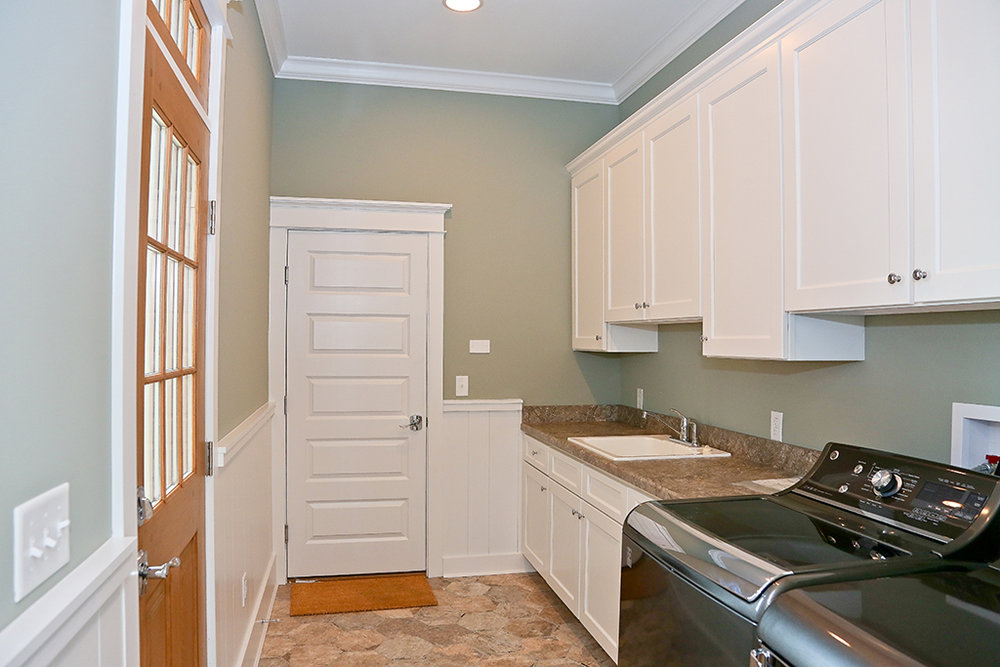 CanalfrontBuilders_wainscoting-laundry-room.jpg