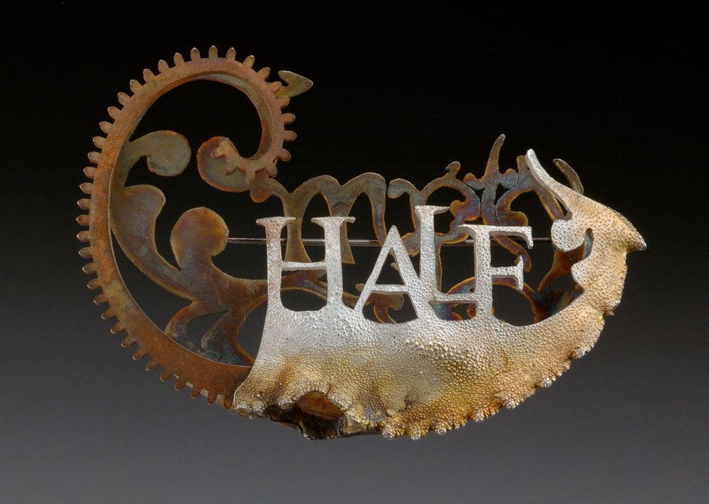 "Title:  ""Half""  Brooch- Silver, bronze.  3"" x 2"""