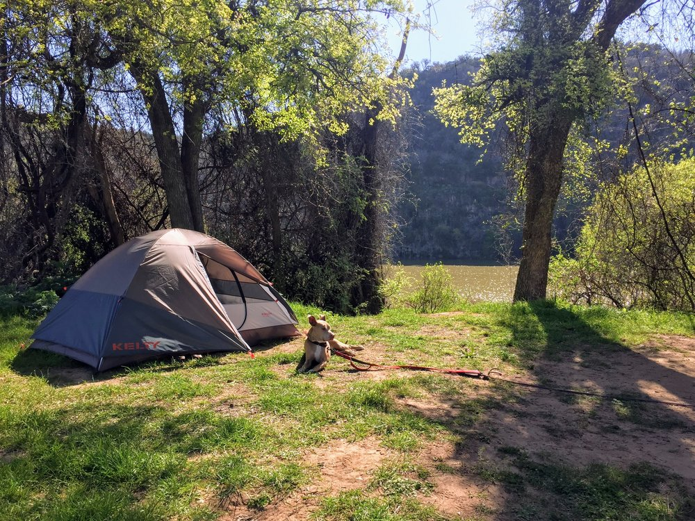 View of the lazy Coloroado River from our campsite. Coca the Catahoula basks in the springtime sun.