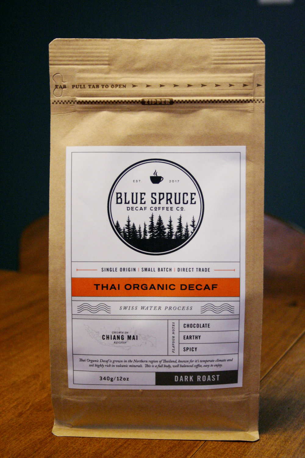 A bag of Blue Spruce Decaf Coffee Company's Thai Organic Decaf Coffee.