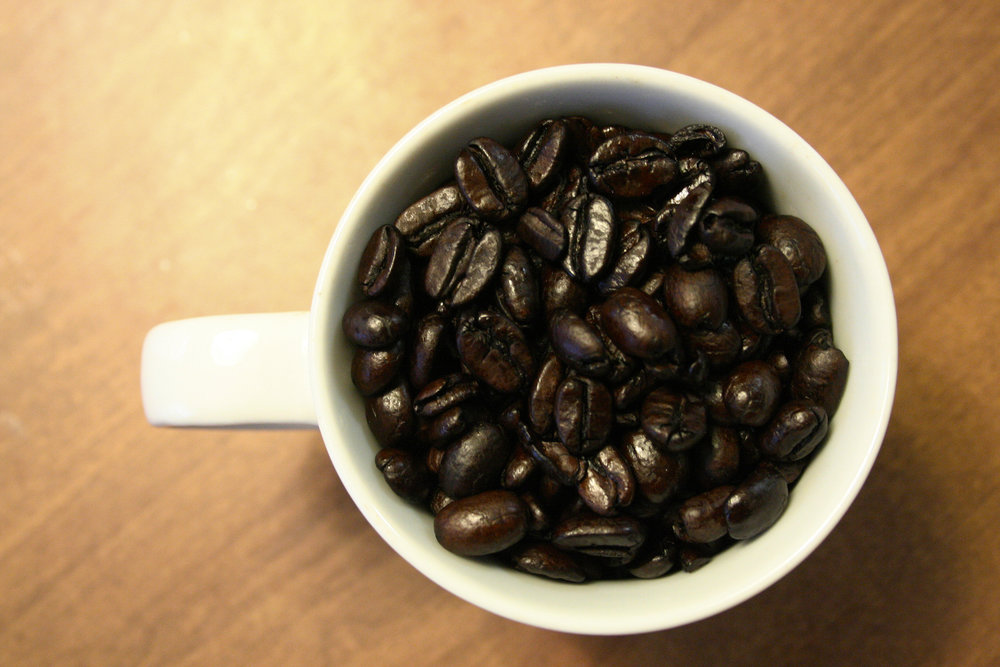 Beautiful, dark roasted Thai Organic decaffeinated coffee beans from Blue Spruce Decaf Coffee Co.