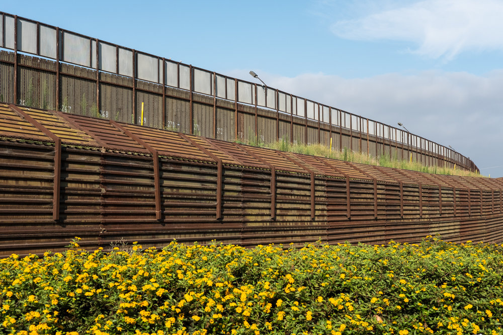 13. Hinterland - Border wall behind outlet stores, San Ysidro, CA.jpg