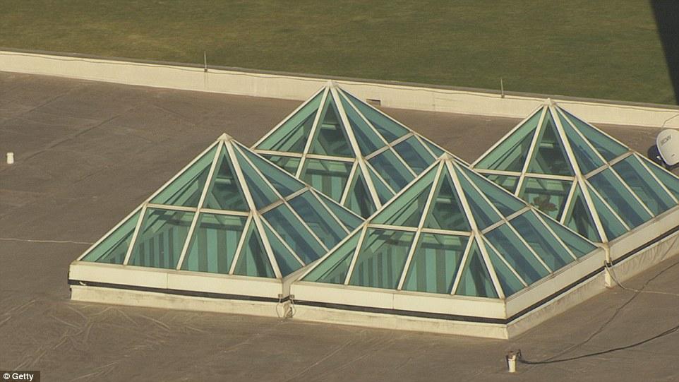 Four-Pyramids-On-Top-Of-Building.jpg
