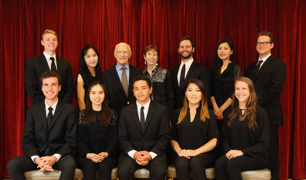 2018 Zarin Mehta Fellows pictured with lead sponsors Linda and Michael Keston: back row: Ryan Toher clarinet, Gi Yeon Yoon violin, Michael Marks double bass, Yuan Qi viola, Michael Cox trombone, front row: William Welter oboe, Choi Tung Yeung violin, Nathaniel Silberschlag horn, Jenny Kwak cello, Hannah Hammel flute.