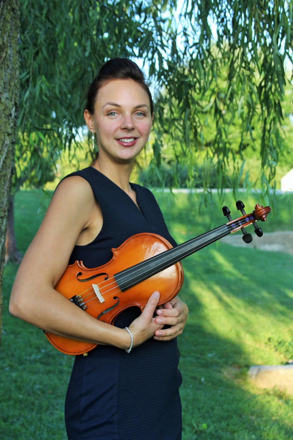 Zhenya Zianouka - Zhenya Zianouka was born in the Republic of Belarus. She grew up among a family of dedicated musicians with her mother, a music teacher and conductor, and father, an accomplished composer and performer. Zhenya started playing the violin at the age of six. She attended the Oginsky School of Music in her hometown of Molodechno, where she studied violin, piano, and music theory for eight years. During her studies, she participated in classical violin competitions and appeared on stage, performing contemporary music on the electric violin. After her graduation, Zhenya was accepted into the prestigious Minsk State Linguistic University, where she was recognized for her scholastic talents and foreign language proficiency. Upon moving to the United States, Zhenya was awarded a scholarship to study Violin Performance at Hood College in Frederick MD, where she held the position of Concert Master in the university string ensemble. Her awards and acknowledgements include  the prestigious Marie A. Markow Excellence in Music Prize and The Ardine and Phyllis Gorden Music Scholar Award.A classically trained artist, Zhenya Zianouka offers individualized instruction on the violin. She tailors the curriculum according to the personal goals of each student. Zhenya helps unleash musical abilities while providing a solid classical foundation. A number of her students sit First Chair Violin in youth orchestras, with others having continued their musical pursuits through higher education.Zhenya specializes in teaching all levels of violin,  beginner to advanced, ages 4 and up.