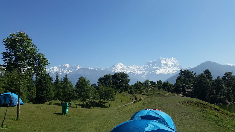 Campsite on night 1 of our 3-day trek in the Himalayas - snow-capped mountains in the background.