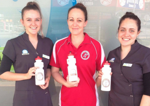Staff members Zoe and Mariah with Bellbird Bombers Manager