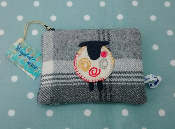 Kath Heywood Designs - A lovely range of hand knitted gloves and scarves along with these cute little purses made from recycled fabric.