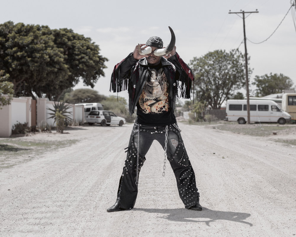 """Botswana, Gaborone, 2015, Portrait of 27 years old """"Cybok"""": """"I work as a security guard, I started listening to heavy metal in 2008, I liked the way the metal heads dressed and behaved""""."""
