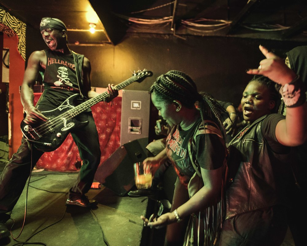 Botswana, Gaborone, December 2015, Rockers enjoying a concert by Remuda, Barren Barrell and Skinflint, 3 heavy Rock metal bands from Botswana at Club Zoom.