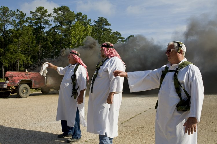 USA, Louisiana, Ft. Polk, 2008, Local residents are hired at $12.87 an hour to dress up as Iraqis and act out various scenarios designed to help soldiers train for deployment. Here, a car accident has occurred.