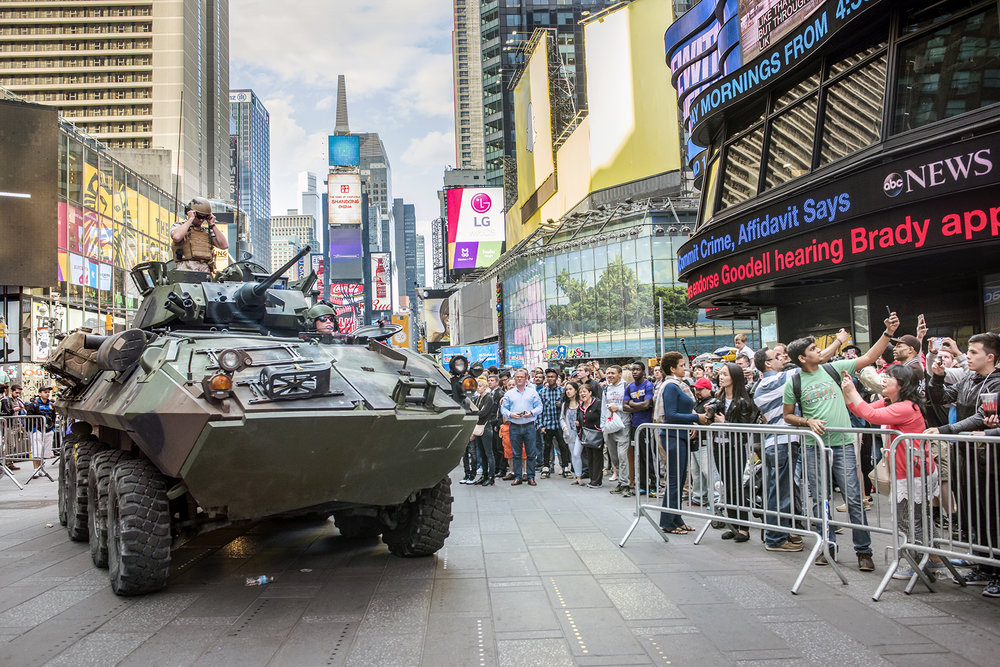 USA, New York City, May 2015, US Marines in Times Square for Fleet Week - demonstration weapons including rifles and arriving in an armored personnel carrier.