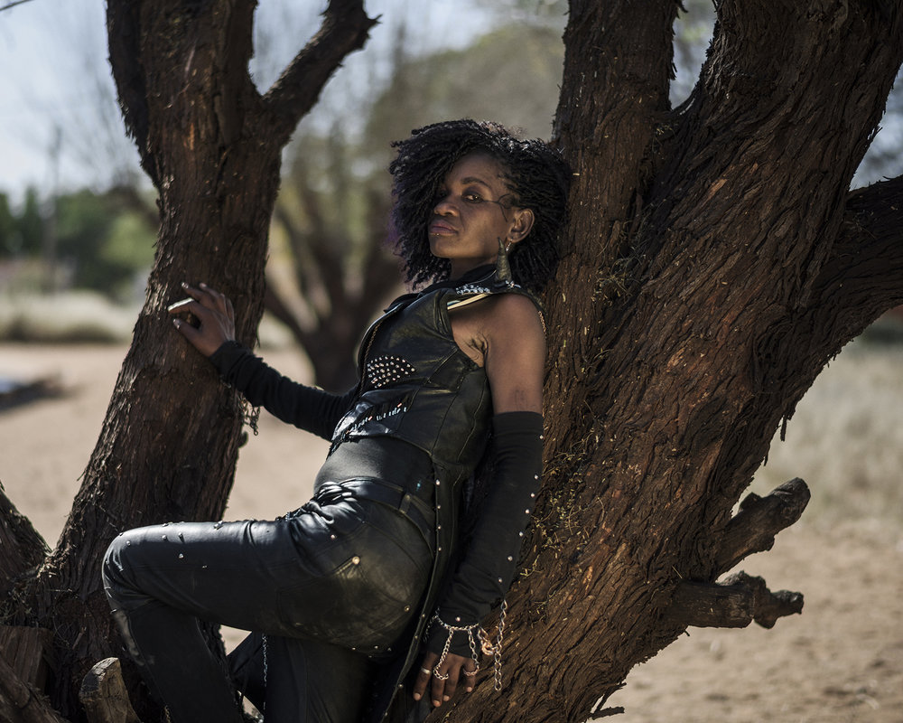 """Botswana, Ghanzi, May 2017, Edith """"Gee Rock""""Seremane, 32 years old from Lobatse, visits the Ganzi Festival for the 2nd time. She started listening to heavy metal when she was 15 years old."""