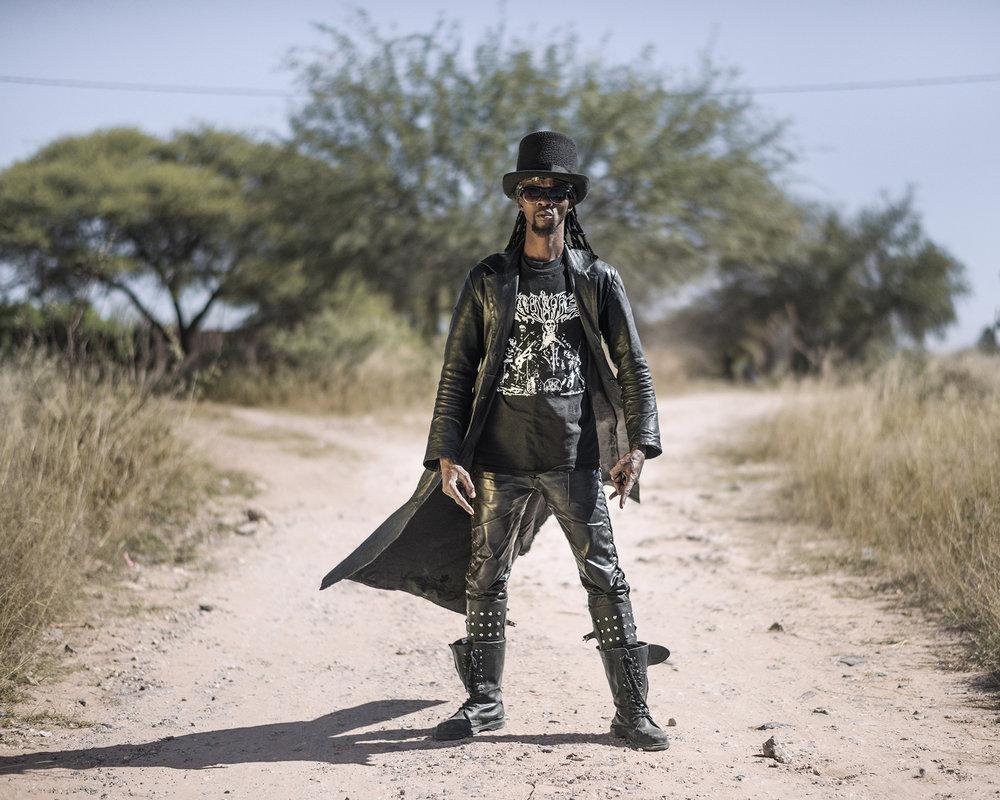 """Botswana, Ghanzi, May 2017,Tshepho Kaisara aka """"Dawg"""", guitarist at Overtrust,and bass guitar player at Raven In Flesh."""