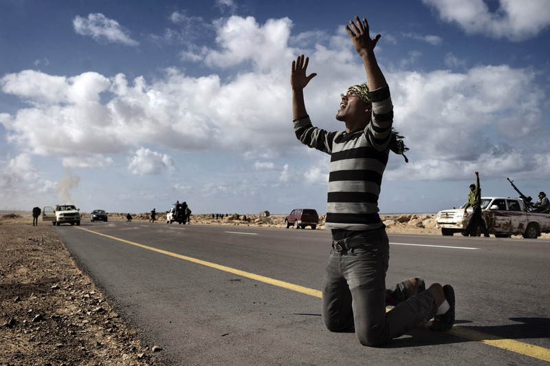 BEN JAWAD, LIBYA - MARCH 06: A Libyan rebel prays  on the frontline