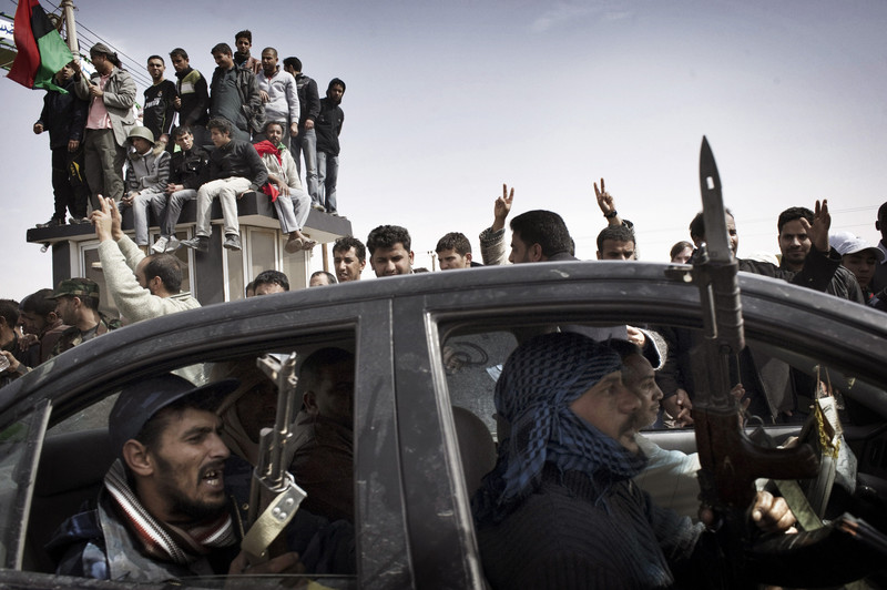 AJDABIYA, LIBYA - MARCH 02: Rebel fighters advance towards the front line against Libyan government forces