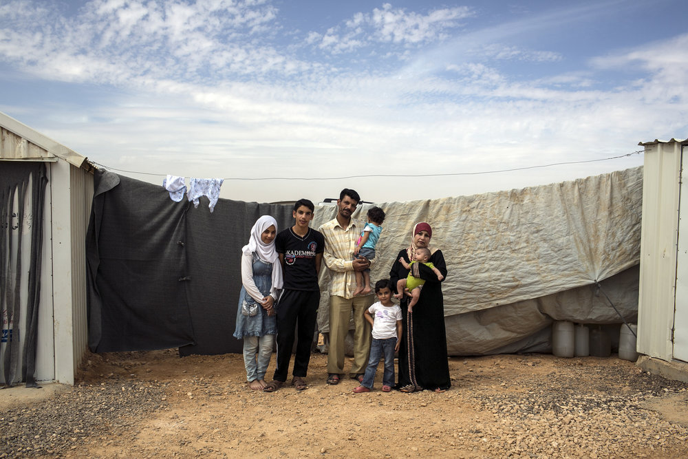 A Syrian refugee father who made decision to leave  his family in refugee camp to Germany receives his fake passport. The family looks at passport and goes outside to discuss leaving, when children get emotional and tent becomes to hot. 