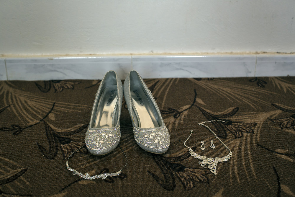 "The dress was a rental, but Hala's ""Cinderella"" shoes and costume wedding jewelry remain with her."