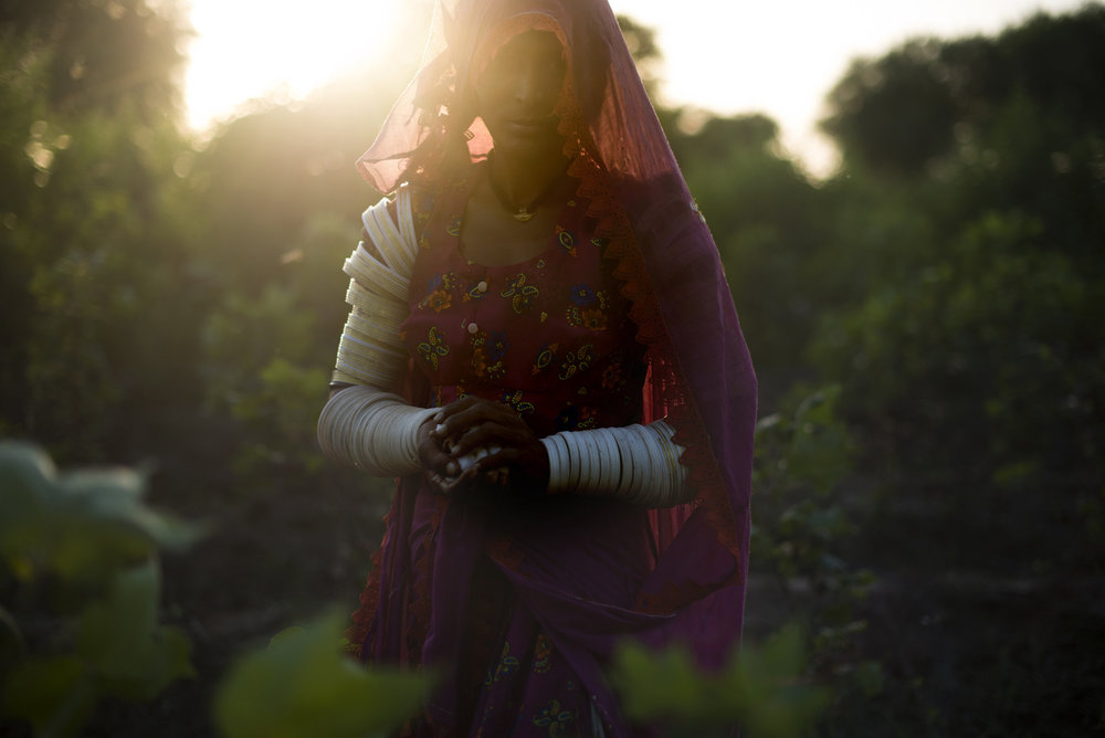 """Nanju Bheel, 25, is one of many Hindu women living and working cotton fields in southern Pakistan. """"In the day we are working in the scorching sun. In the night we are passing through the snakes,"""" she said."""