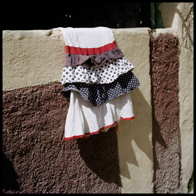 Haiti, Port au Prince, July 2016. A little girl skirt is drying in the sun.