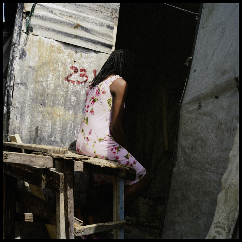 """Haiti,Port-au-Prince, July 2016. Sarah, 13 years old. The mother of Sarah: """"Our tent was broken and had a big hole in it. he came through it. He rape Sarah. She was on her own. """""""