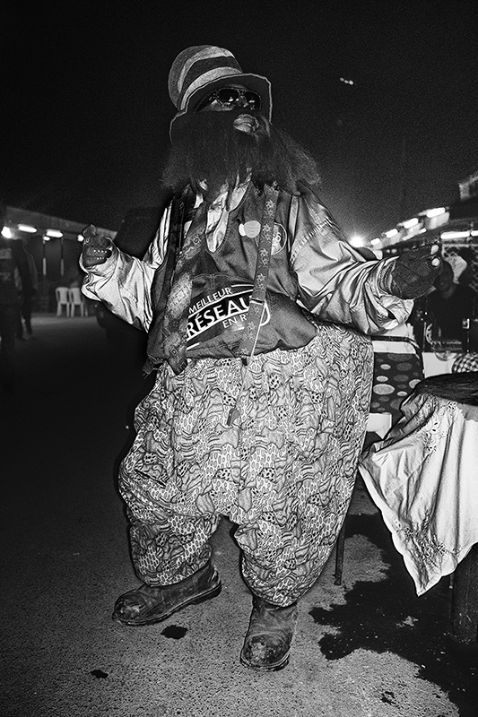 D.R. Congo, Lubumbashi, October 2013. A street entertainer in the street of the Kenya nieghbourhood in Lubumbashi.