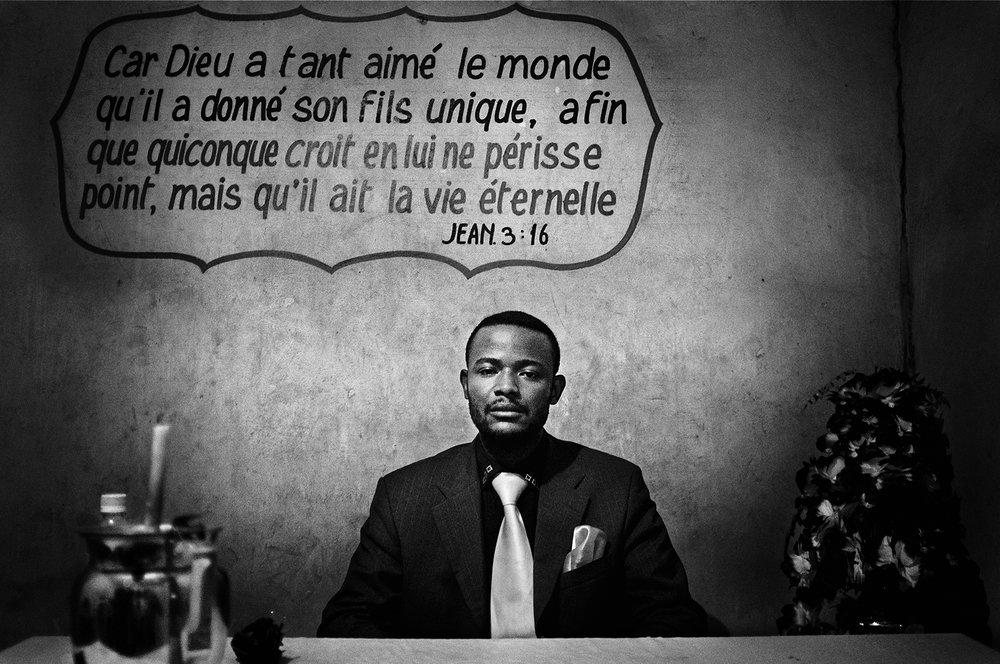 D.R. Congo, Kinshasa, October 2011. Pastor Elysée Arc En Ciel posing in his office in Kinshasa Commune (Kinshasa).