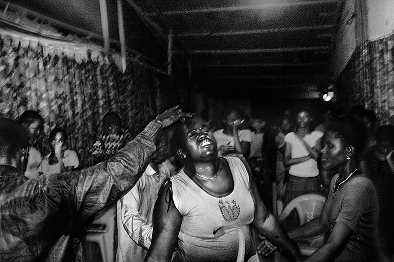 D.R. Congo, Kinshasa, October 2011. Exorcism during the evening cult in Barumbu commune (Kinshasa).